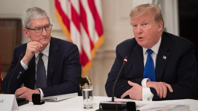 President Donald Trump speaks alongside Apple CEO Tim Cook (L) during the first meeting of the American Workforce Policy Advisory Board