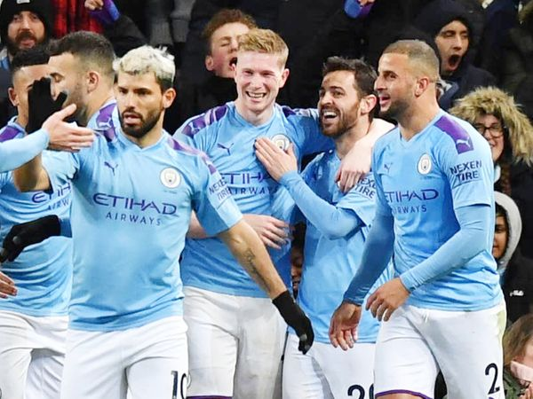 Manchester City's team celebrated after scoring a goal.