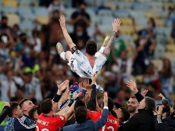 In football, the coach is usually thrown in the air after winning the title.  Argentine players gave this honor to their star Messi.