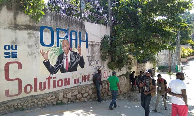 The photo is of Port o Prince.  Here a picture of President Jovenel Mois has been made on the wall built on the side of the road.