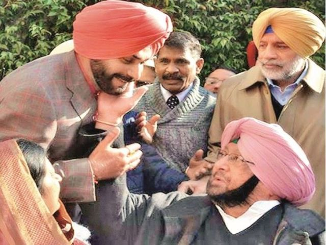 This picture taken during an event in 2018 tells a different story, but the tussle between Captain and Sidhu has been going on since 2017.  file photo