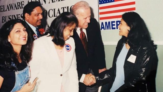 Biden shaking hands with Gujarati Reuters Rekha Patel.  Rekha lives in Delaware.  (File)