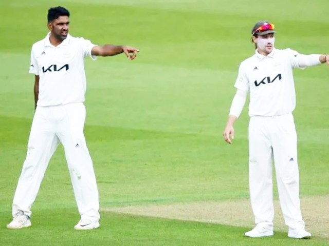 Surrey captain Rory Burns talking to Ashwin during the match.