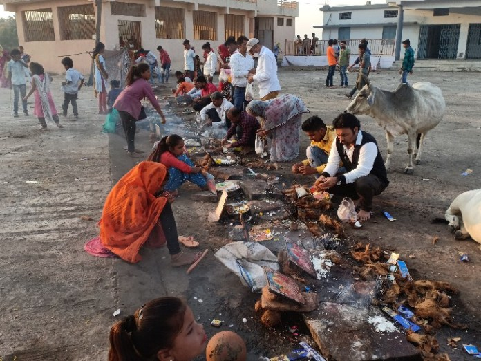 Offering prasad after worshiping the girls.