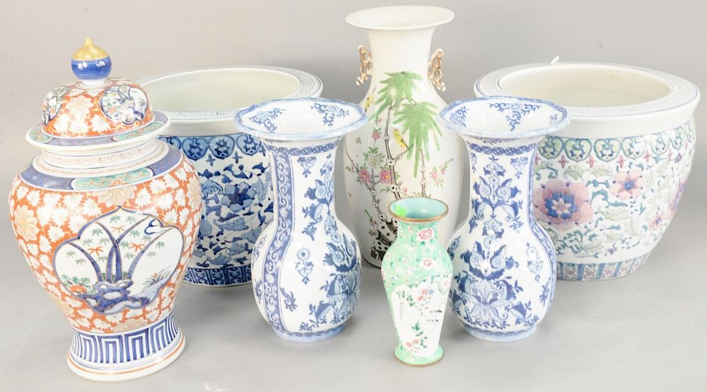 Seven Oriental pieces, Chinese porcelain vase, enameled vase, Japanese urn, pair of blue and white vases, and two chinese planters, heights 9 in., to