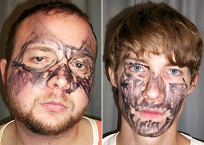 Tried to hide their faces ... Matthew McNelly, 23, and Joey Miller, 20.