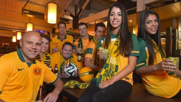 Looking forward: Socceroos fans meet in a Melbourne restaurant to plan their trip.