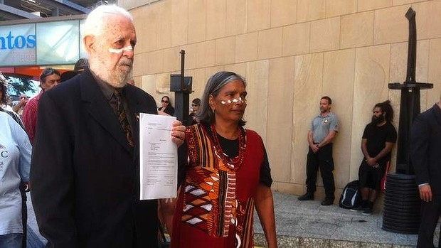 Quandamooka elders Bob Anderson, holding the paper, and Evelyn Parkin at the Commonwealth Law Courts in Brisbane on June 6, 2014