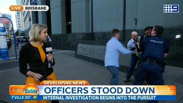 A Today reporter had her live cross interrupted by a dramatic arrest on Friday.
