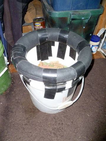 Five-gallon bucket with pipe insulation duct-taped to its lip for comfort.