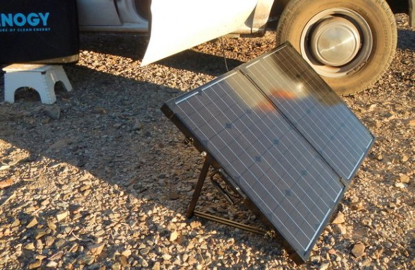 The minimum amount of solar I recommend is 100 watts. While its best to mount it on the roof, if you can't a portable suitcase system like this one from Renogy works very well.
