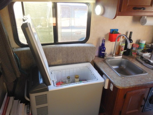 His camper came with a 3-Way fridge, but he decided he prefered a 12 volt compressor fridge for it's energy efficiency. This is his Engle which easily runs off his solar saving him from burning propane.