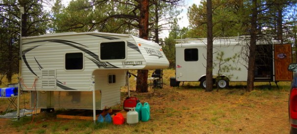 He has all the cozy comforts of home in his camper, and all the luxury of a Man-Cave in his cargo trailer conversion.