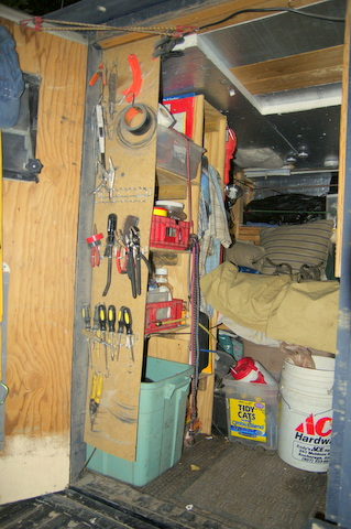 The left  hand shelf unit at the back of the truck used for storage.