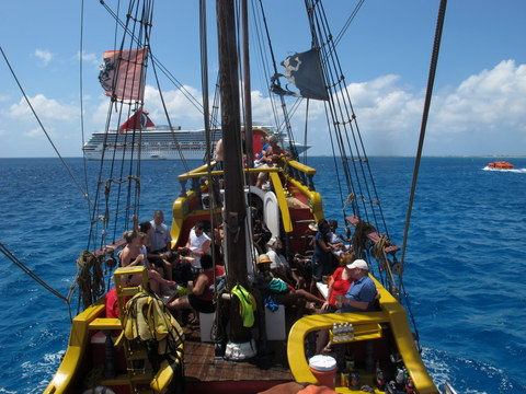 The Pirate Ship sailing past the Cruise Ship.