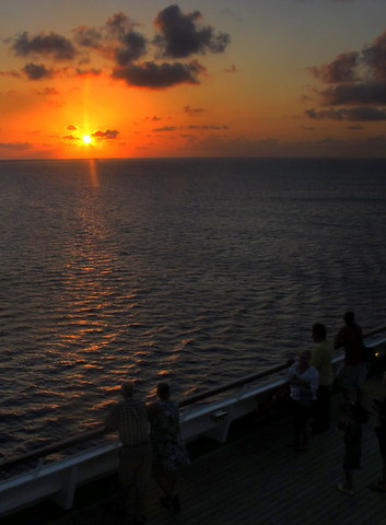 At sunset, a few nature lovers gathered on deck to watch it set.