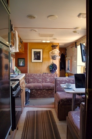In this picture you are looking forward toward the office from the back of the trailer. You can see the hallway where he stores the panels for transport just inside the door.