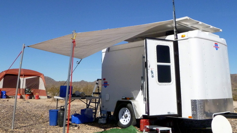 You can see how I create shade when parked in the desert. First, ladder racks and plywood cover the roof, putting it in the shade. Second, an awning shades the wal