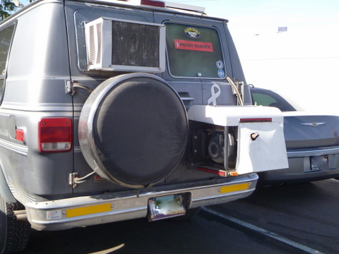 here you see a window air conditioner mounted in the back window of a van