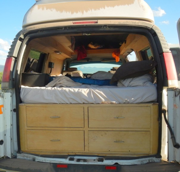 Looking in from the back door you can see he built the bed across the van and built it up on a platform with drawers. They make excellent use of the large storage area under the bed.