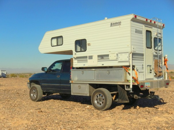 This is their current adventure vehicle. It's a Dodge Cummins 4x4 flatbed and a Lance Ultra-Light camper. Like Pavlov's dogs, I start drooling every time I see it!