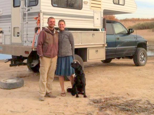 Forest, Beth and Sprocket in front of their current adventure vehicle.