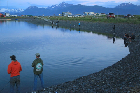 I took this picture of fisherman at the lagoon at midnight to demonstrate how much light there is and how Alaskans our out playing all night in the summer. You can't really see them but there were more than a dozen people fishing in this picture.