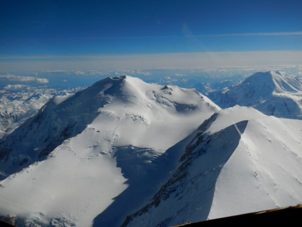 McKinley has twin peaks. On the right is the lower South Peak and on the left is the higher North Peak. That's Mt. Foraker behind them