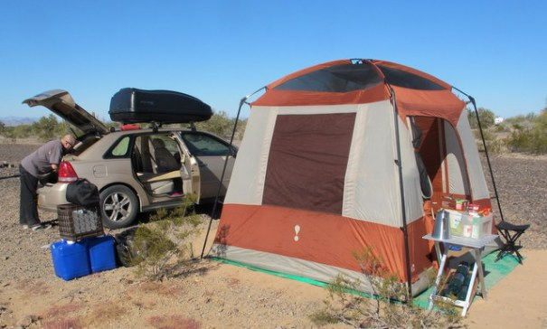 This is a later year Chevy Malibu and it only gets 28 MPG, but it is much larger allowing you to set up a much more comfortable camp. It is also large enough to sleep comfortably inside during bad weather.