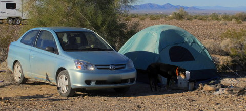 This Toyota gets 40 MPG and can carry enough to set-up a very comfortable camp