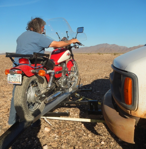 Here I am loading my Honda Rebel 250 on the front rack of my van.  Motorcycles are bigger, heavier and much more powerful than most scooters. That makes them harder to handle than a scooter, but it also means you can ride them on the freeway--which is a really big advantage!