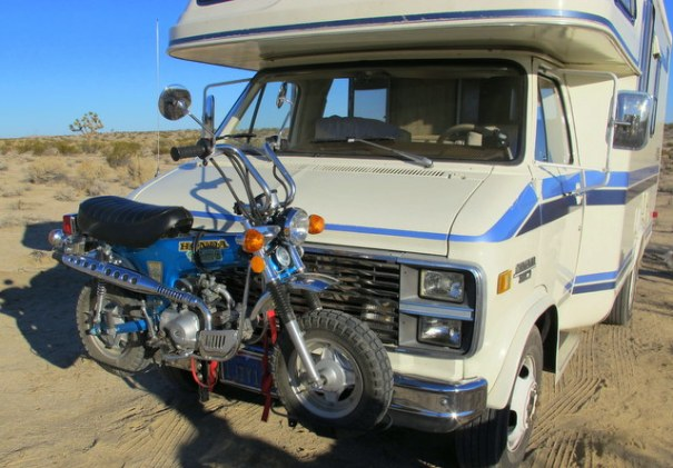 This is also an outstanding set-up. It's a small Class C carrying a Honda Trail 70 in a front rack. All the Honda Trail bikes are a great choice because they get 100 MPG or more, they are very reliable and they are so small they are easy to put on a rack. They are small and light, have  an automatic transmission and have a step-through frame. Anybody can ride and handle one of these little babies!