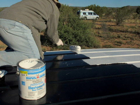 If you have a dark van, painting the roof will really help.