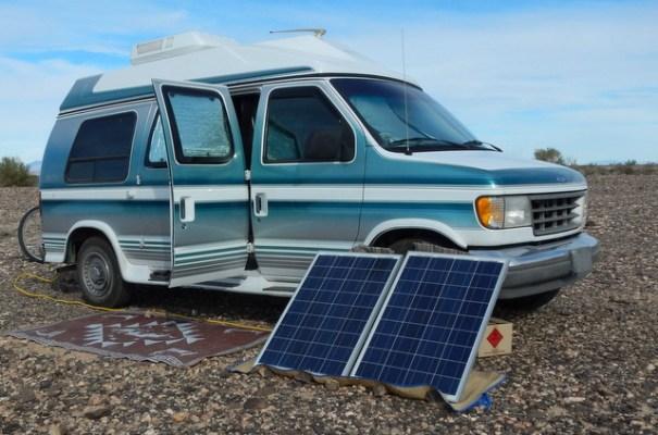 My friend Dandeions very nice conversion van and her two new Renology 100 watt panels.