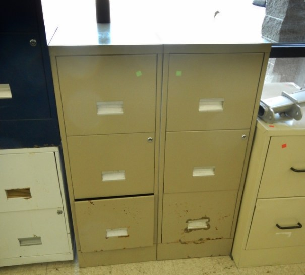 These matching 3-drawer filing cabinets were $5 each. They provide instant organization but you can go a step further.  You can spread them apart cut a piece of plywood to set over the top of them and it becomes desk. If you can find a used door and set it over the top of them it can become your bed.!