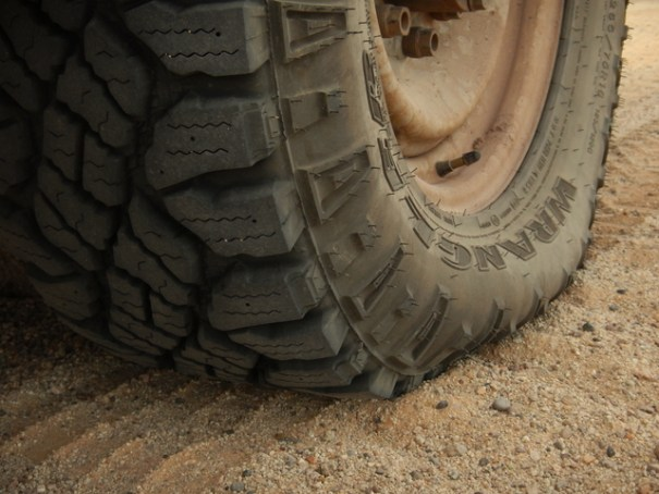 Here I was stuck in sand later on with the exact same tire. This time I aired down and rolled right out of the hole. Notice the lugs on the sidewall are laid right down into then sand. That makes the tire wider adding flotation and also gives it greater traction.