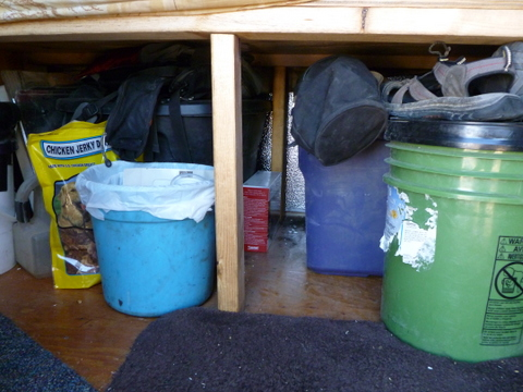 Storage under bed. Here you also see the middle leg