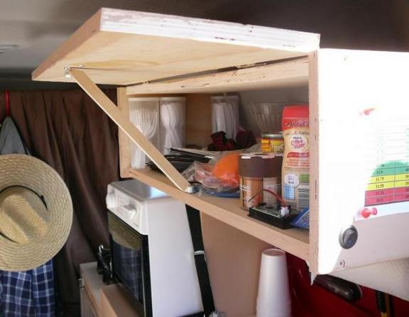 The top cabinet opened. Great storage!