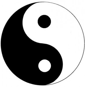 This is the Yin Yang symbol from Taoism. It very graphically shows the dance of oppsoites naturally flowing endlessly into one another and always containing the kernel of the other in itself.