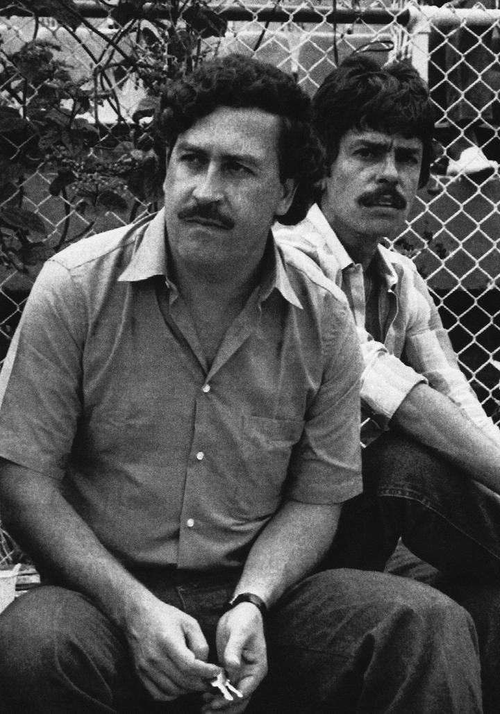 In this 1983 photo, Medellín cartel boss Pablo Escobar watches a soccer game in Medellín, Colombia.  Jairo Velasquez Popeye (AP Photo, File)