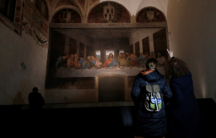 """Two young people watch """"The Last Supper"""", Da Vinci's painting dating from 1494-1498.  Photo: AP"""