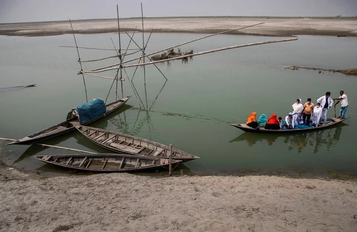 Health workers boating on the Brahmaputra River in the state of Assam, India.  Photo: AP