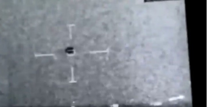 An image of the video recorded from a US Navy ship.  The UFO, in the center (Video capture).