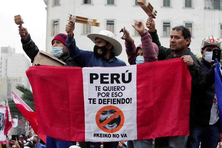 Pedro Castillo's supporters during a support march in Lima on Saturday.  Photo: AP