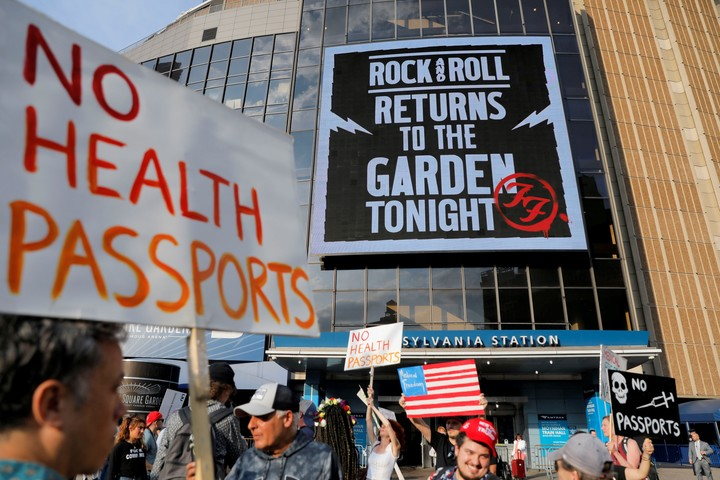 Anti-vaccine protesters gather outside Madison Square Garden before a Foo Fighters show.  Reuters photo