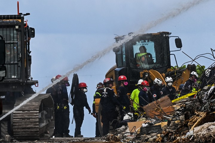Rescuers search the pile of rubble for survivors.  AFP photo