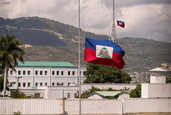 The Haitian national flag flies at half mast at the National Palace in Port-au-Prince, Haiti.  Photo EFE