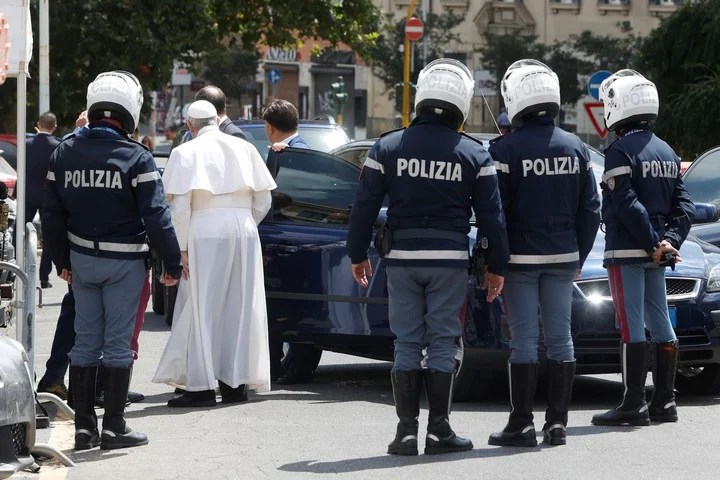 Francis greets police officers upon arrival at the Vatican.  Photo: AP