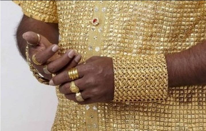 The gold shirt and jewelry that the millionaire always wore.