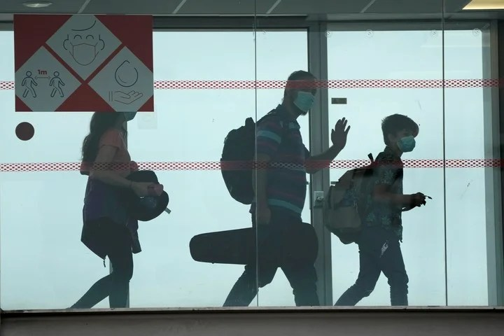 Passengers recently arrived from Kabul, to the Charles Gaulle airport.  Photo: AP